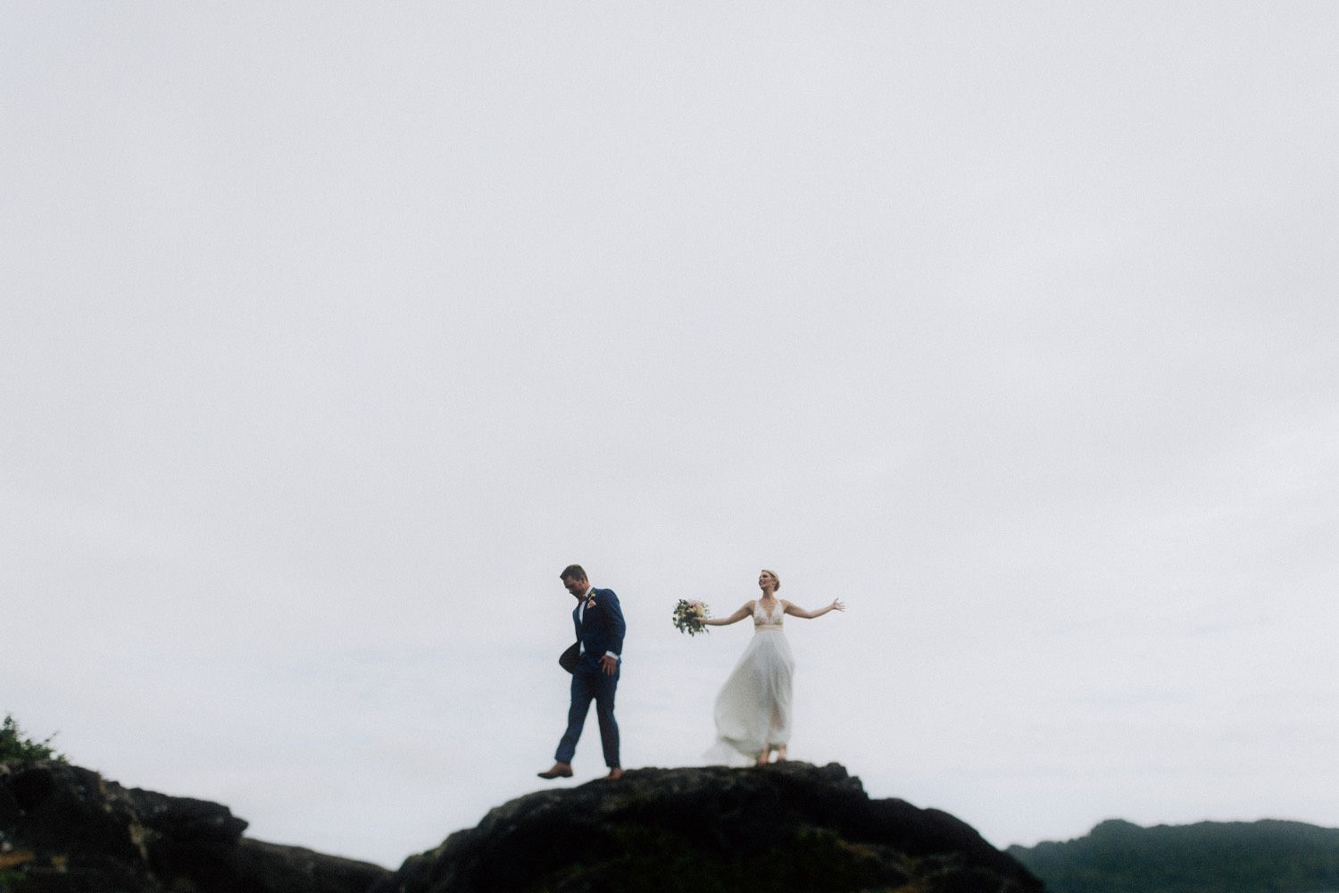 wedding couple eloping on a cliffside in tofino bc