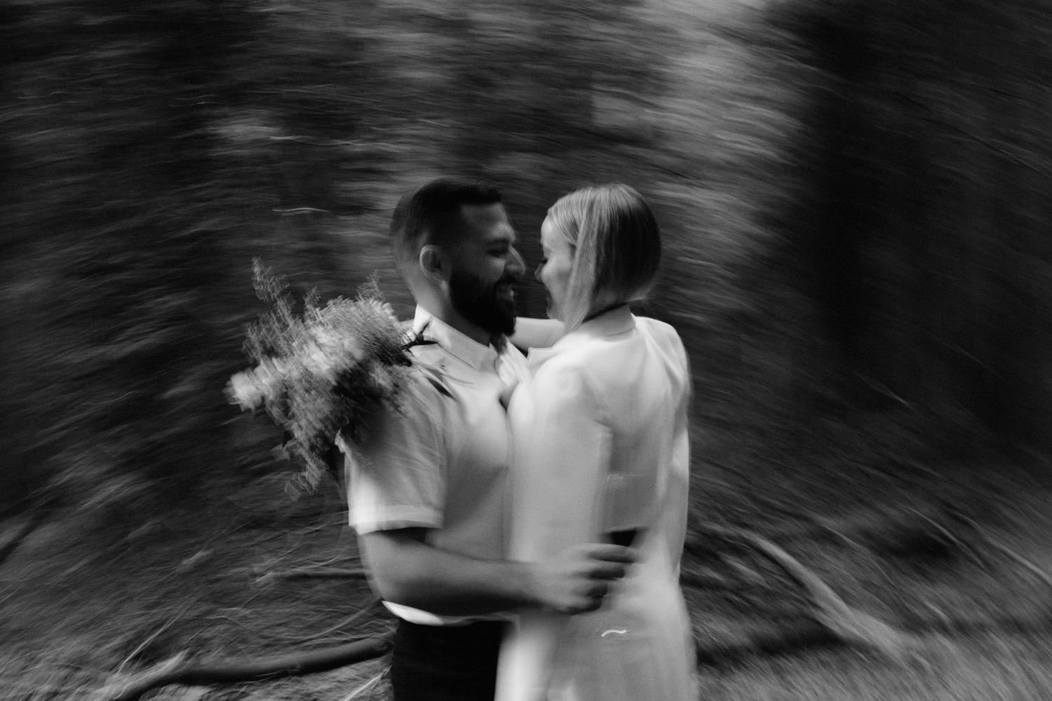 blurry photo of wedding couple during elopement at pacific spirit park in vancouver