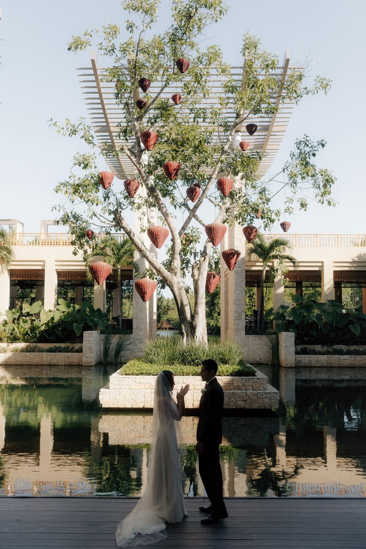 wedding couple having first look at banyan tree mayakoba