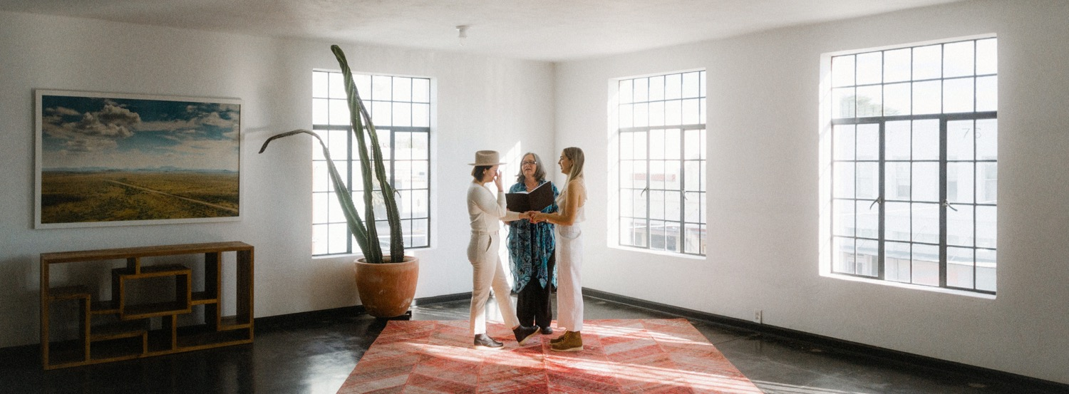 lesbian couple getting married indoors during elopement in marfa