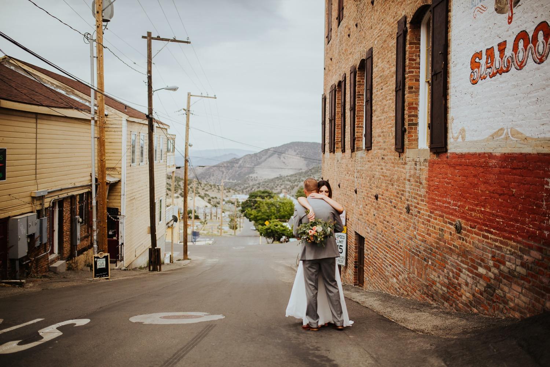 Bride hugs groom in Virginia City