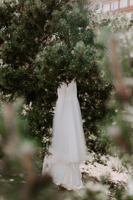 Wedding dress hanging near Temppeliaukion kirkko Helsinki.