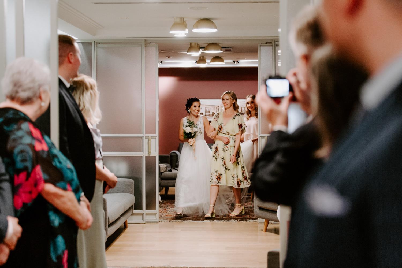 Bride walking down the aisle in St. George Hotel Helsinki.