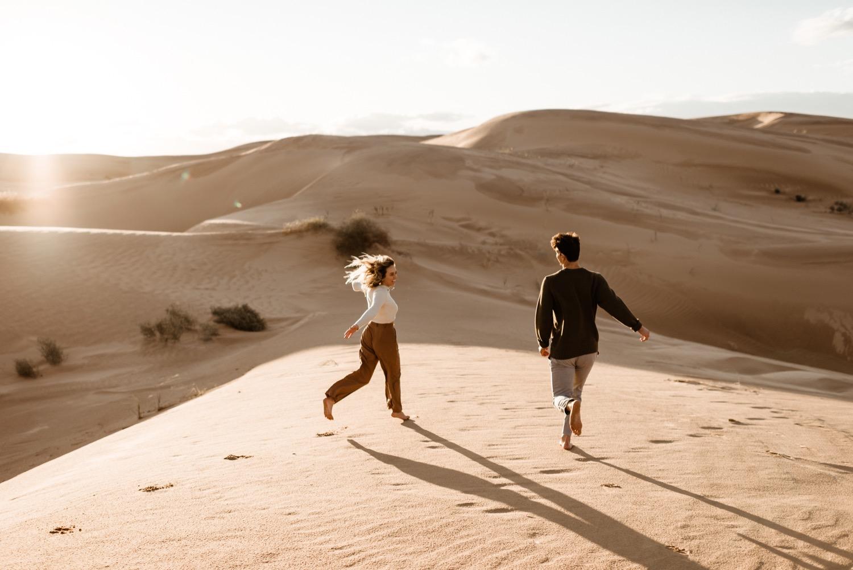 https://content1.getnarrativeapp.com/static/e6714104-0423-4032-936b-4ed5a5d9665b/glamis-Sand-dunes-San-diego-engagement-photos-adventurous-engagement-photos-death-valley-engagement-photos.jpg